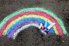 Chalk drawing: colorful rainbow. Chalk drawing on asphalt: colorful rainbow Royalty Free Stock Images