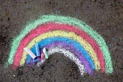Chalk drawing: colorful rainbow. Chalk drawing on asphalt: colorful rainbow Royalty Free Stock Photo