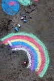 Chalk drawing: colorful rainbow. Chalk drawing on asphalt: colorful rainbow Stock Photo