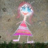 Chalk drawing. A chalk drawing on concrete by a 7 year old girl stock photos