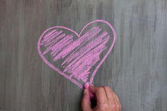 Chalk drawing heart shape stock images