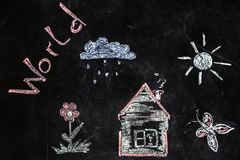 Chalk drawing of house and sun on a black background,. Children`s chalk drawing of house and sun on black background the concept of nature and the environment stock image