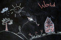 Chalk drawing of house and sun on a black background,. Children`s chalk drawing of house and sun on black background the concept of nature and the environment royalty free stock images