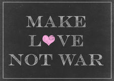 Chalk drawing - make love not war on a Chalkboard Stock Photography