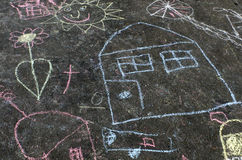 Chalk drawing. Picture of a house on road or pavement royalty free stock photography