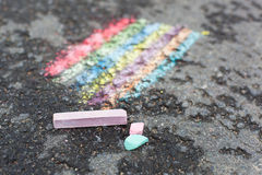 Chalk drawing of rainbow. And color chalks on asphalt Royalty Free Stock Photos