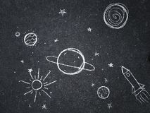 Chalk drawing. Space, planets and stars painted by children`s.