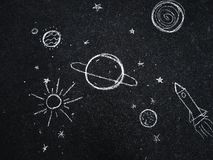 Chalk drawing. Space, planets and stars painted by children`s. stock illustration