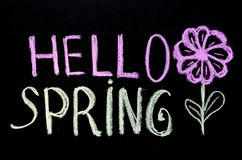 Chalk drawing text `hello spring` on blackboard royalty free stock photos