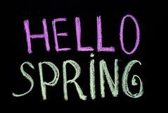 Chalk drawing text `hello spring` on blackboard stock photos