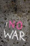 Chalk drawing : Words NO WAR. Colorful chalk drawing on asphalt: Words NO WAR royalty free stock image