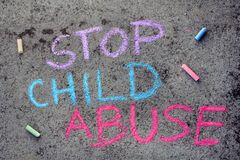 Chalk drawing: words STOP CHILD ABUSE. Colorful chalk drawing on asphalt: words STOP CHILD ABUSE stock image