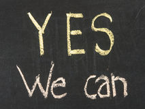 Chalk drawing - Yes we can. On chalk board royalty free stock image