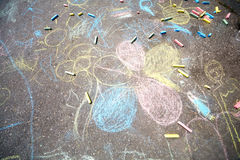Chalk drawings. Made by children on asphalt, and pieces of chalk Royalty Free Stock Images
