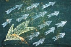 Chalk drawn arrows on the blackboard royalty free stock photos