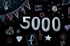 Chalk drawn number 5000 on the board.  Stock Photo