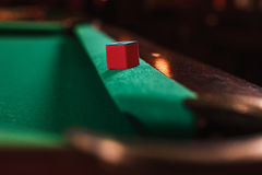 Chalk on the edge of the billiard table. Stock Photo