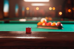 Chalk on the edge of the billiard table. Stock Image