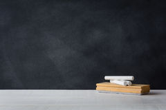 Chalk and eraser board on the white desk. Blackboard background. With education concept royalty free stock photos