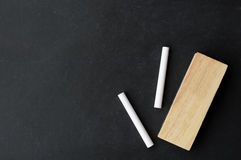 Chalk and eraser on chalkboard Stock Photography