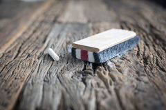 Chalk eraser. On a wooden table Royalty Free Stock Photo