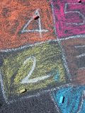Chalk games. Numbers and frames written by children with colored chalks Stock Photo