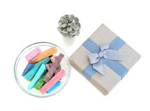 Chalk and gift box. Chalk colored and gift box grey, silver bump, on a white background stock photos