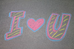 Chalk hand drawing alphabet,. I LOVE YOU  on chalkboard background Royalty Free Stock Images