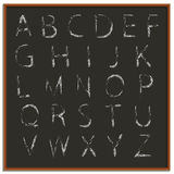 Chalk hand drawing alphabet, vector illustration. Vector illustration of chalk hand drawing alphabet on a blackboard background Stock Photo