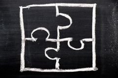 Chalk hand drawing as puzzle shape on black board. Background royalty free stock photo