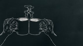 Chalk hand drawing two hands holding coffee cup with steam and cheers on black board near left side stock photos