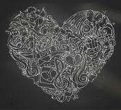 Chalk hand-drawn doodles heart on blackboard background. Royalty Free Stock Photo