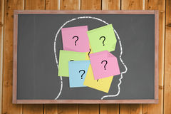 Chalk head with question mark post it notes. Digitally generated Chalk head with question mark post it notes Royalty Free Stock Photography