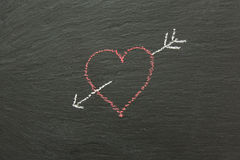 Chalk heart with arrow drawn on a chalk board. Royalty Free Stock Image