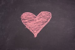 Chalk heart drawing. On a blackboard royalty free stock photos