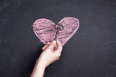 Chalk heart drawing and key stock images