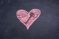 Chalk heart drawing and key royalty free stock photos