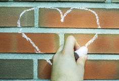 Chalk heart. Simple heart form drawed with chalks on a brick wall Royalty Free Stock Photography