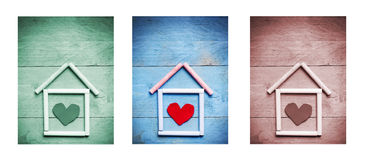 Chalk house with heart shape inside on wooden background, triptych in green, blue and brown Stock Photo