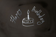 Chalk inscription happy birthday cupcake with candle.  Stock Photos