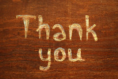 Chalk  inscription thank you. Chalk  note thank you on wood background Royalty Free Stock Image