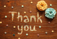 Chalk  inscription thank you. Chalk  note thank you on wood background Stock Photo