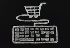 Chalk keyboard connected to cart, shopping concept Stock Images