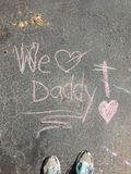 Chalk We Love Daddy With Shoes Stock Photo