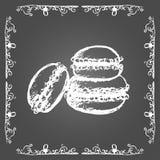 Chalk macarons and vintage frame. Royalty Free Stock Image