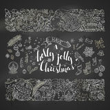 Chalk Merry Christmas decorations and design elements on blackboard background. Royalty Free Stock Image