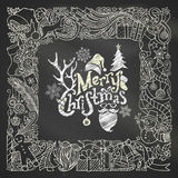 Chalk Merry Christmas frame on blackboard background. Stock Photos