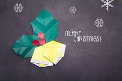 Chalk Merry Christmas text with origami bells Royalty Free Stock Images