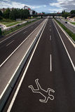Chalk outline on the road. Chalk outline of a road accident victim stock photo