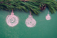 Chalk painted Christmas balls on the green background. Royalty Free Stock Images